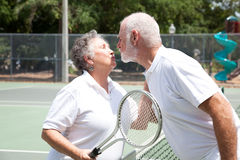 Tennis Seniors Kiss Royalty Free Stock Images