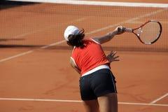 Tennis Serve. Close-up of female tennisplayer royalty free stock photo