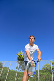 Tennis serve - man tennis player serving playing. Tennis outside in summer. Fit male athlete practicing. Healthy active sport lifestyle Stock Photos