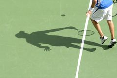 Tennis shadow 02. The shadow of a man playing tennis on a court Stock Photography