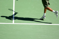 Tennis shadow 08. The shadow of a man playing tennis on a court Stock Photos