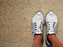 Tennis Shoes on Concrete. Athletic shoes on concrete with room for text and copy Royalty Free Stock Image