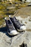 Tennis Shoes by Creek. Tennis shoes on a rock by a creek stock photos