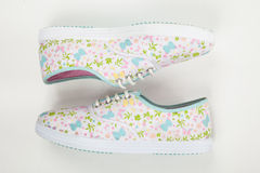 Tennis shoes for women on white background Stock Photos