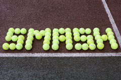 Tennis Smash shot. Created using tennis balls on a hard court surface Royalty Free Stock Photos