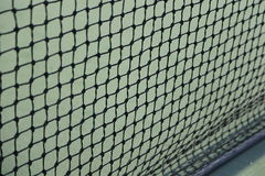 Tennis som är netto som bakgrund Arkivfoton