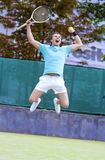 Tennis Sport Concept: Portrait of young Exclaiming Male Caucasian Tennis Player With Raquet Outdoors on Court. Vertical Image Composition stock photos