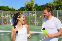 Tennis sport - couple relaxing after playing game Royalty Free Stock Image