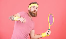 Tennis sport and entertainment. Athlete hipster hold tennis racket in hand red background. Man bearded hipster wear stock photos