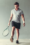 Tennis. Sport, lifestyle and  people concept - young man tennis player in action Stock Images