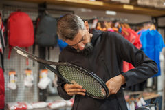 Tennis stringer doing racket stringing. Stringing Machine. Tennis stringer doing racket stringing in his workshop Royalty Free Stock Image