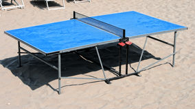 Tennis-table on Sand Stock Photography