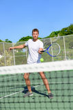 Tennis - Tennis player hitting volley by the net Royalty Free Stock Photos