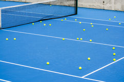 Tennis. There are a lot of tennis balls on the tennis court Royalty Free Stock Image