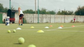 Tennis training. tennis coach pitches in the big tennis stock video footage