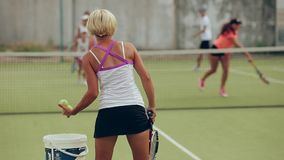 Tennis training. tennis coach pitches in the big tennis stock video