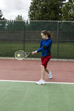 Tennis two handed Backhand for Lefthanded Player. Young girl using a two handed backhand for lefthand tennis Player Royalty Free Stock Photography