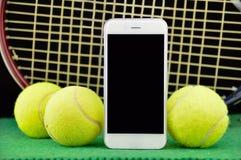 Tennis und Telefon Lizenzfreies Stockbild
