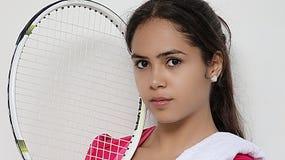 Tennis und weiblicher Knabe Lizenzfreies Stockbild
