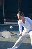 Tennis Volley. Female hitting volley stroke in tennis Stock Image