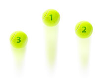 Tennis winner podium. At a championship suggested by three balls jumping with first second and third place on them suggesting tennis rankings at a grand slam or royalty free stock images