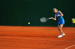 Tennis woman. Woman practicing tennis sport outdoor Royalty Free Stock Photos
