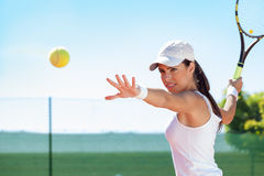 Tennis. Woman tennis player hitting ball stock photo