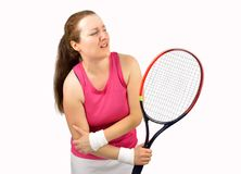 Tennis woman player injured. Tennis woman player with elbow injury holding the racket isolated over white background Royalty Free Stock Image