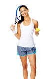 Tennis woman portrait. Healthy happy smiling hispanic woman with a wristband poses with a tennis racket and ball Royalty Free Stock Photo