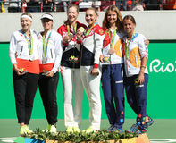 Tennis women's doubles medalists team Switzerland (L), team Russia and team Czech during medal ceremony Royalty Free Stock Photo