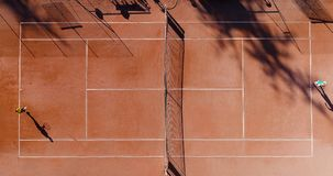 Tennis young players. Aerial view Stock Photos