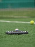 Tennis5. The tennis racket lays on a green grass after game Stock Photo