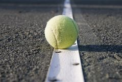 Tennisball On The Line Royalty Free Stock Photo