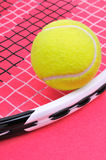 Tennisball on the racket Stock Photos