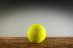 Tennisball wood shadow light Stock Images