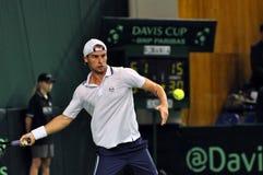 Tennisman Adrian Ungur i handling på en Davis Cup match Arkivfoton