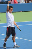 Tennisprofi Kei Nishikori feiert Sieg nach Erstrunde US Open 2014 Lizenzfreie Stockbilder