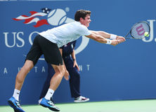 Tennisprofi Milos Raonic während an dritter Stelle der Runde sondert Match an US Open 2013 aus Stockbilder