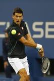 Tennisprofi Novak Djokovic während des Viertelfinalematches an US Open 2013 gegen Mikhail Youzhny Lizenzfreies Stockbild