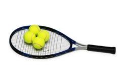 Tennisschläger und vier Kugeln Stockbilder