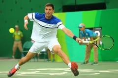 Tennisspelare Federico Delbonis av Argentina i handling under matchen för runda för singlar för man` s först av Rio de Janeiro 20 Royaltyfria Foton