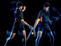 Tennisspelaremanljus som målar isolerad svart bakgrund royaltyfri fotografi