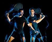 Tennisspelaremanljus som målar isolerad svart bakgrund fotografering för bildbyråer