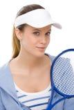 Tennisspieler - Holdingschläger der jungen Frau Lizenzfreie Stockbilder
