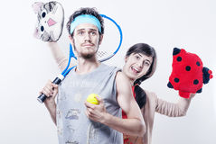 Tennisspieler mit einer roten Cheerleader Lizenzfreie Stockfotografie