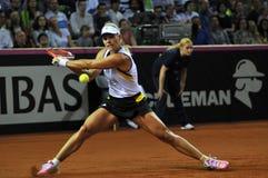 Tennisvrouw in actie Stock Afbeelding