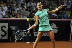 Tenniswoman in actie Royalty-vrije Stock Afbeeldingen