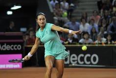 Tenniswoman in action Stock Photo