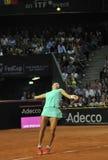 Tenniswoman nell'azione Fotografie Stock Libere da Diritti