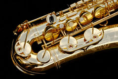 Tenor Saxophone close-up. Close up of the lower half of a tenor saxophone royalty free stock photo